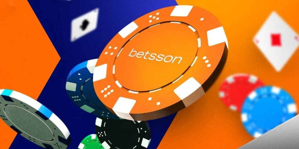 spelmarker i olika färger med fokus på en orange och vit där det står betsson